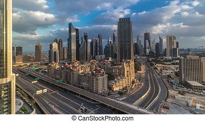 Skyline morning view of the buildings of Sheikh Zayed Road and DIFC timelapse after sunrise in Dubai, UAE. Skyscrapers in financial centre aerial view from above in downtown