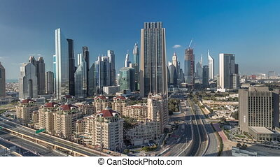 Skyline view of the buildings of Sheikh Zayed Road and DIFC timelapse in Dubai, UAE. Skyscrapers in financial centre aerial view from above in downtown