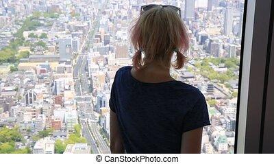skyline window woman