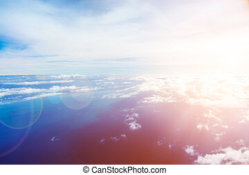 Skyline with lensflare effect - Airplane view with colorful ...