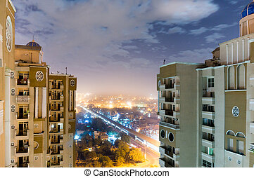 Skyscapers with the noida cityscape showing between them -...