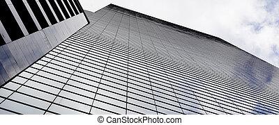 A glass-clad skyscraper in Singapore