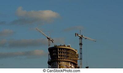 Skyscraper and cranes at work
