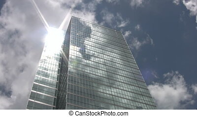 Skyscraper and sun. Timelapse. - Timelapse shot of sun...