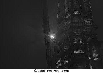 Skyscraper construction at nicht. Office glass building