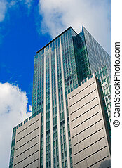 Skyscraper front view with blue sky