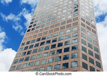 Skyscraper - middle part of a modern skyscraper against blue...