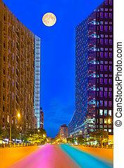 Skyscraper moon light concept with colored fast roads