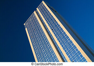 Skyscraper on a background of clear blue sky