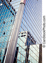 skyscraper reflected in skyscraper with suggestive color hues