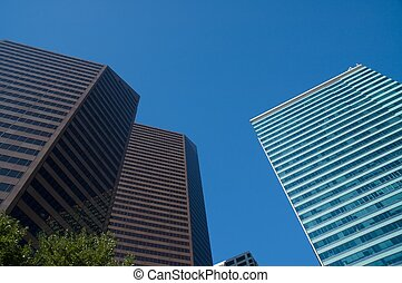 skyscraper - Reflection of structure on glass walls of...
