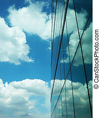 Skyscraper with reflection heart shape of clouds