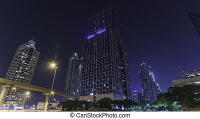 Skyscrapers at the Sheikh Zayed Road at night in Dubai timelapse hyperlapse