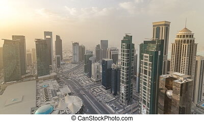 Skyscrapers before sunset timelapse in the skyline of commercial center of Doha