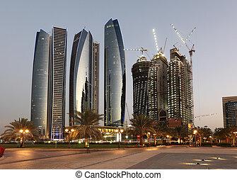 Skyscrapers in Abu Dhabi at dusk, United Arab Emirates