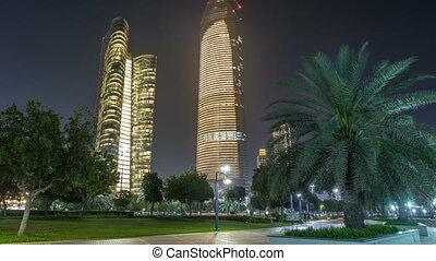Skyscrapers in Abu Dhabi Skyline at night timelapse, United Arab Emirates