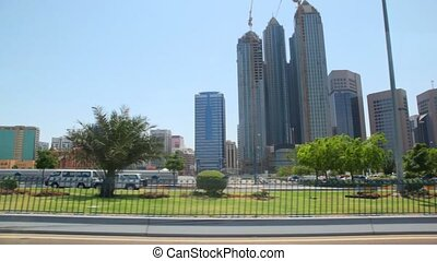 skyscrapers in Abu Dhabi, view from moving car