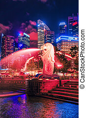 Skyscrapers Merlion statue at Merlion Park at dusk