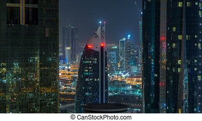 Skyscrapers of dubai during night hours timelapse. Close up...