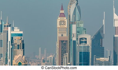 Skyscrapers on Sheikh Zayed Road and DIFC aerial timelapse in Dubai, UAE. Towers at Financial Centre at evening before sunset