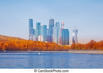 Skyscrapers on the river background.