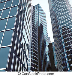 Skyscrapers with blue glass, high rise building, skyscrapers, business concept of successful industrial architecture. 3d rendering