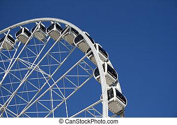 Skyview Ferris Wheel - Skyview Ferris wheel against a blue...