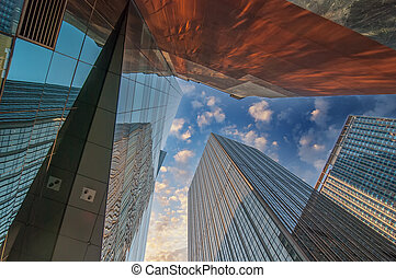 Skyward view of gigantic glass skyscrapers.