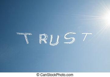 Trust - Skywriting the word Trust on a blue sky with a sun...