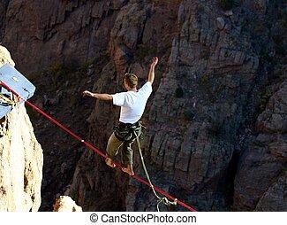 Slack Line Walking - Slack line walker balancing...