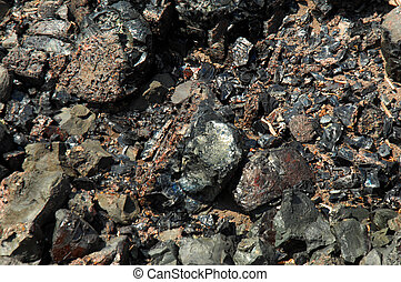 Background image of slag rocks remaining from the copper industry in Hancock, Michigan.