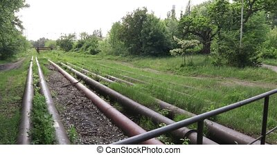 Slag transport pipes - Several large-diameter metal pipes...