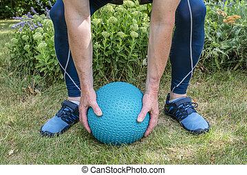 slam ball workout in backyard