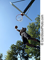 Slam Dunk Basketball - Young basketball player driving to...