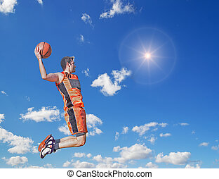 slam dunk in the sun - basketball player dunking in the sun