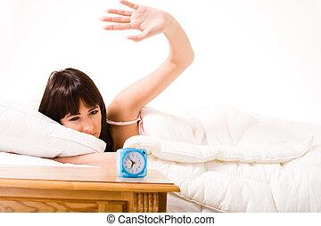 Slapping the anoying alarmclock - Brunette slapping on...