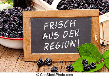 Slate blackboard with the Germans words: Frisch aus der...