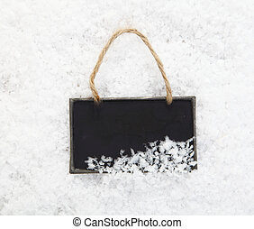 Slate chalkboard in snow