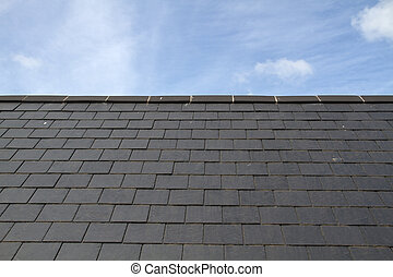 Slate roof against blue sky on the island of Jersey