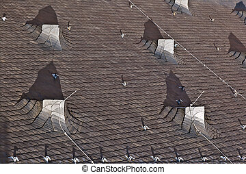 slate roof of a church in the old historic town of Oberursel, Germany.