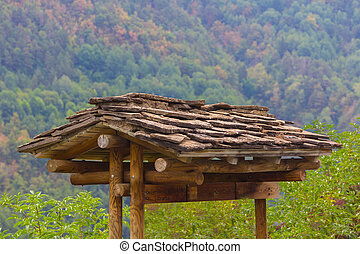 Slate roof with wooden stand