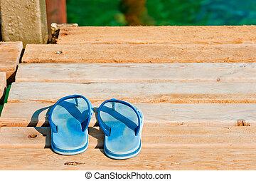 slates on a wooden pier near the sea