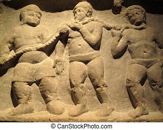 Slaves - A pair of collared slaves on a relief from Smyrna...