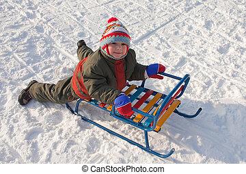 Little child fun winter outdoor snow sport sled