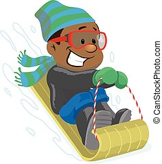 Young boy sledding down a a hill