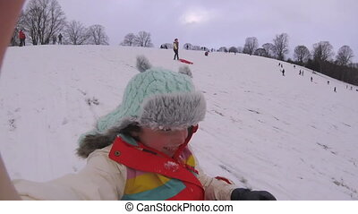 Sledding Down the Hill with Action Cam - Little girl is...