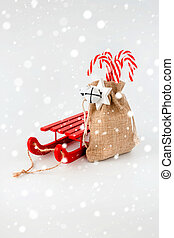 Sledge and Candy Canes in Jute Sack with Snow Flakes