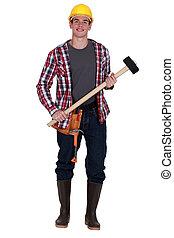 sledge-hammer, lavoratore costruzione, giovane, presa a terra