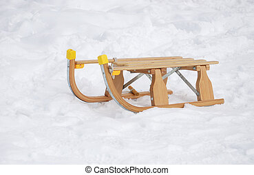 Sledge in snow - Old fashioned wooden sledge in the snow.