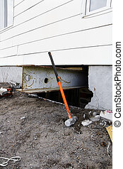 Sledgehammer and steel beam to lift house
